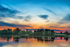 Beautiful sunset above a big river Royalty Free Stock Photo