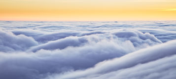 Beautiful sunset above clouds. From airplane perspective. High resolution image Royalty Free Stock Photography