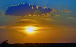 Beautiful sunset above green filed Royalty Free Stock Photos