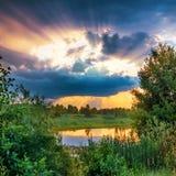 Beautiful sunset above lake Stock Photos