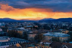 Beautiful sunset above Ljubljana old city and business downtown center. Slovenia. Skyline of European town with Alps mountains. Evening view with scenery and royalty free stock image