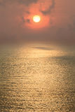Beautiful sunset above the sea in air pollution day. Stock Image