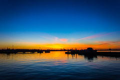 Beautiful sunset above the sea. In harbour Royalty Free Stock Photos
