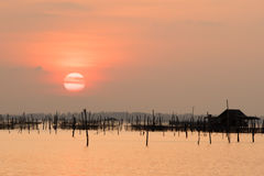 Beautiful sunset above the sea in Thailand. Silhouette of fish farms at sunset.  Stock Image