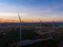 Beautiful sunset above the windmills on the field. Royalty Free Stock Photography