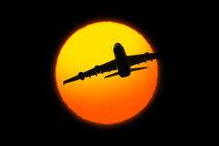 Beautiful sunset with airplane Royalty Free Stock Photography