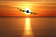 Beautiful sunset with airplane Royalty Free Stock Images