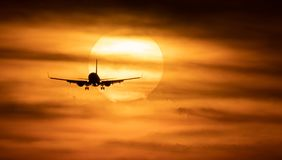 Beautiful sunset with airplane. Travel concept Stock Image