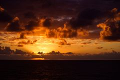 Beautiful sunset in atlantic ocean with amazing clouds Stock Images