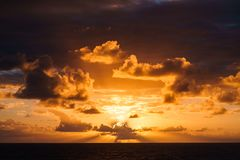 Beautiful sunset in atlantic ocean with amazing clouds Stock Photo