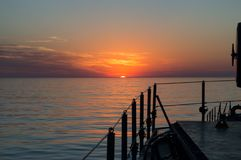 Beautiful sunset at the sea. Beautiful sunset at the atlantic ocean from a military frigate Stock Photos