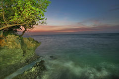 A beautiful sunset on the Atlantics. Sunset, sundown in Sosua, decline the Dominican Republic. A tree branch on a background of setting sun, quiet paradise royalty free stock images