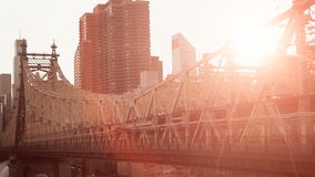Beautiful sunset background bridge lens flare red sky aerial view flying stock footage
