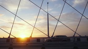 Beautiful sunset background of bridge over water. Transportation traffic in slow motion. 1920x1080. Hd stock video