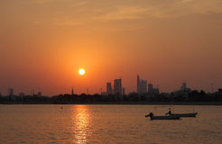 Beautiful sunset with Bahrain skyline and boats Stock Photography