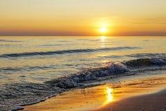 Beautiful sunset on the Baltic Sea coast in Latvia. Waves with splashing water, seashore, coastline, europe, outdoor, nature, summer, enviroment, travel stock photos