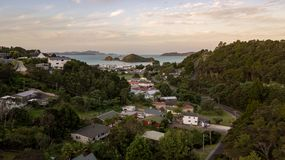 Small Neighborhood In Bay Of Islands. Beautiful sunset in bay of islands, warm light fades over cozy homes Stock Images