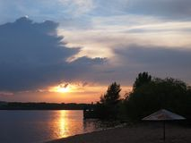 Beautiful  sunset in the bay on the river stock photography
