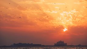 Beautiful sunset at the beach, amazing colors, light beam shining through the cloudscape over the arabian gulf seascape stock video