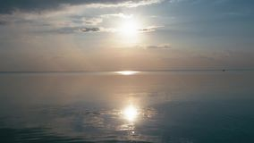 Beautiful sunset at the beach, amazing colors, light beam shining through the cloudscape over the gulf seascape. Sea and. Beach stock video