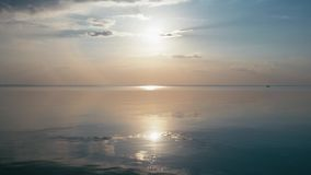 Beautiful sunset at the beach, amazing colors, light beam shining through the cloudscape over the gulf seascape. Sea and. Beach stock video footage
