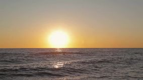 Beautiful sunset on the beach, amazing colors, a ray of light, sparkling through the clouds above the sea stock video