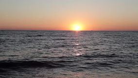 Beautiful sunset on the beach, amazing colors, a ray of light, sparkling through the clouds above the sea. Nature stock video footage