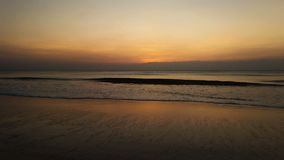 Beautiful sunset at the beach. Beautiful golden sunset at the sandy beach at the end of a beautiful summer day stock footage