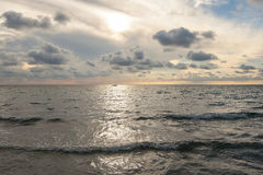 Beautiful sunset  at the beach with big clouds in Salento - Italy. Beautiful sunset at the beach with big clouds in Salento Stock Image