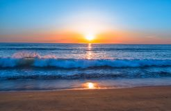 Beautiful Sunset on the Beach in Blue, Pink, and Orange Colors royalty free stock photo