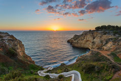 Beautiful sunset in the beach in Carvoeiro at sunset. Stock Image