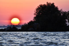 The beautiful sunset on the beach. Beautiful sunset on the beach. Danub delta Stock Images