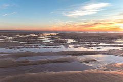 Beautiful sunset at the beach. A beautiful sunset in the fine sand beach during a winter evening Stock Photography