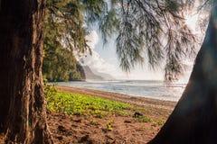 Beautiful sunset at the beach on the Paradise island. Beautiful sunset at the beach on the island of Kauai near Na Pali cliffs. Paradise island Royalty Free Stock Photography
