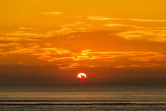 Beautiful sunset on the beach in island Koh Phangan, Thailand. Royalty Free Stock Images