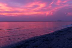 A beautiful sunset on a beach in Koh Lanta, Thailand, the sky ablaze with purples and blues reflected in the ocean. Nobody in the image royalty free stock photo