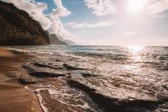 Beautiful sunset at the beach on the Paradise island. Beautiful sunset at the beach on the island of Kauai near Na Pali cliffs. Paradise island Stock Image