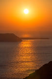 Beautiful sunset at the beach of Santorini in Greece Stock Image