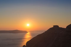 Beautiful sunset at the beach of Santorini in Greece Stock Photos