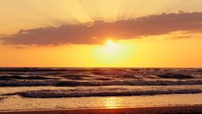 Beautiful sunset on the beach, sea waves, sea shore. 4k stock video footage