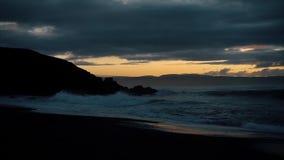 Beautiful sunset on the beach. Waves on stone. Beautiful sunset on the beach. Sun, sky, sea, waves and sand stock video