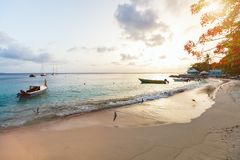 Beautiful sunset. At beach on tropical island royalty free stock photo