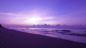 Beautiful sunset on the beach with violet sky stock video footage