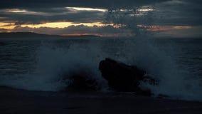 Beautiful sunset on the beach. Waves on stone. Beautiful sunset on the beach. Sun, sky, sea, waves and sand stock video footage