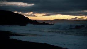Beautiful sunset on the beach. Waves on stone. Beautiful sunset on the beach. Sun, sky, sea, waves and sand stock footage