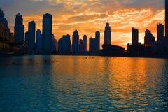 Beautiful Sunset behind buildings. Sunset Behind Buildings outside of Dubai Mall & Burj Khalifa, Dubai UAE Royalty Free Stock Photo