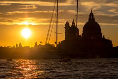 Sunset behind the Church of Madonna Della Salute in Venice Stock Photo
