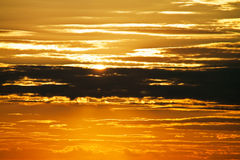 Beautiful sunset behind the clouds Royalty Free Stock Photography