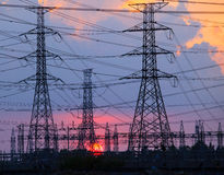 Beautiful sunset behind electricity plant industry estate use as Royalty Free Stock Images