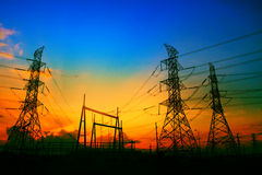 Beautiful sunset behind electricity plant industry estate use as Stock Image
